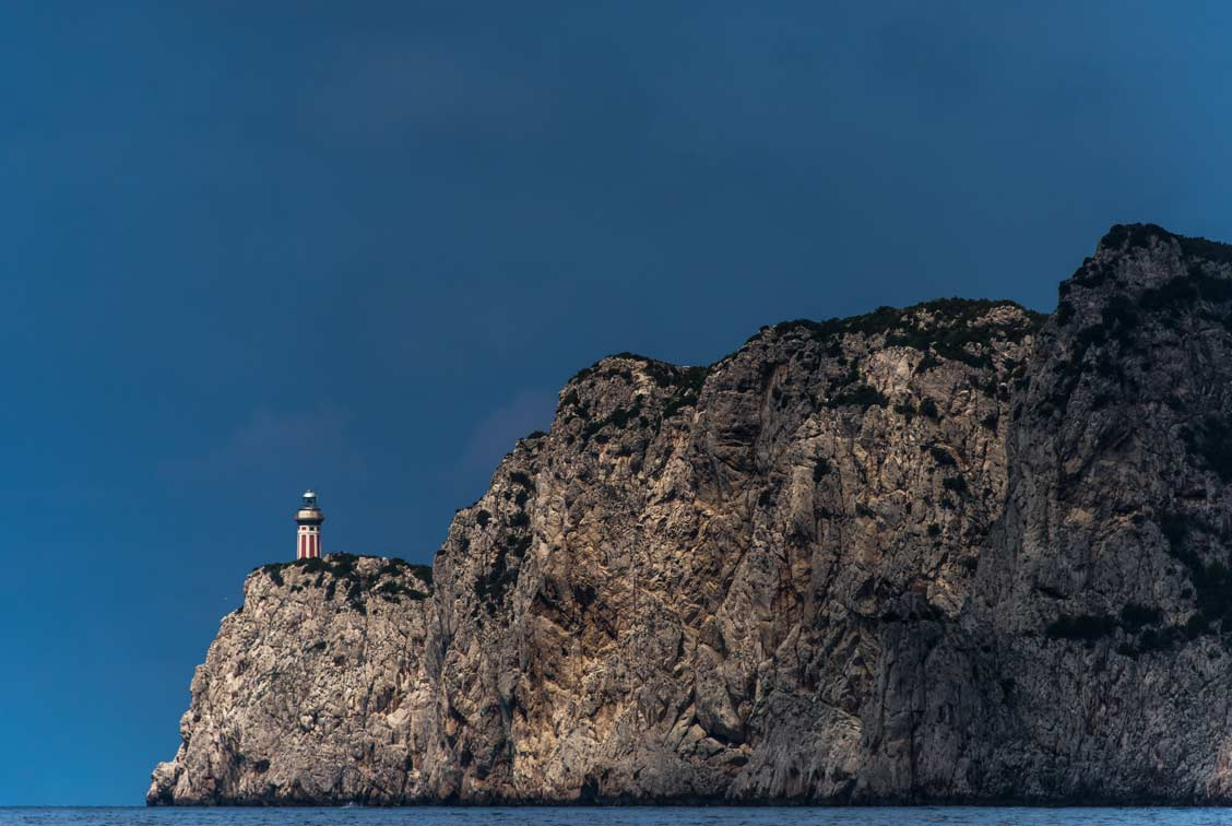 At sunset, a lighthouse on the island of Capri, off the coast of Italy.